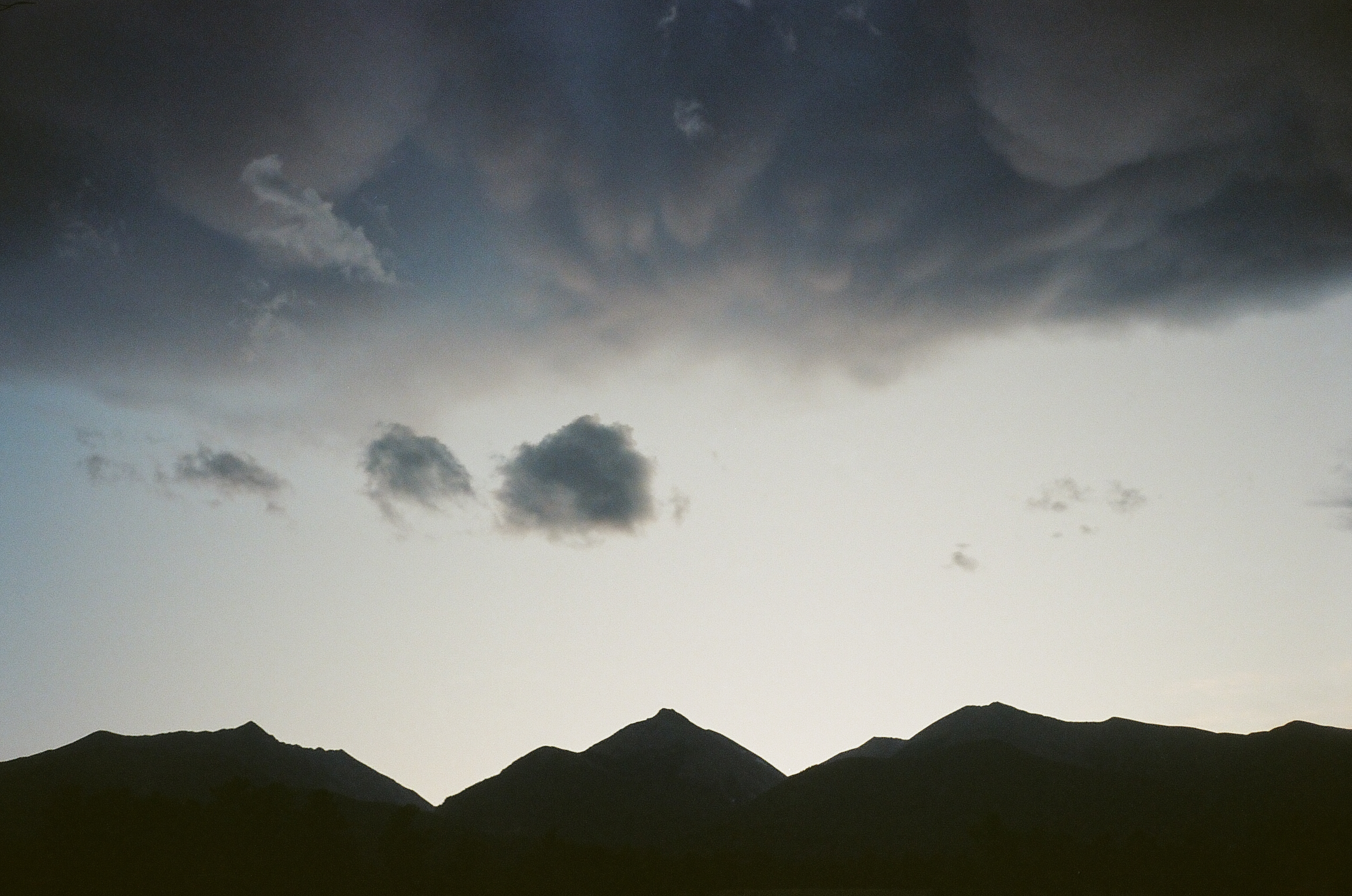 Rocky Mountain Collegiate Peaks in silhouette with clouds Nathrop, CO, August 2017 | photo © NSS